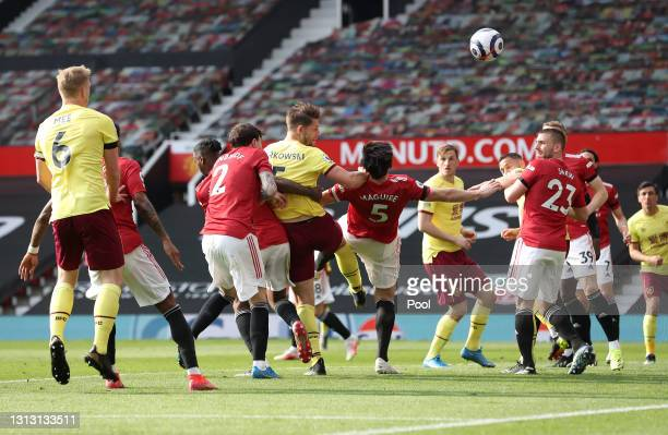 James Tarkowski of Burnley scores his team's first goal during the Premier League match between Manchester United and Burnley at Old Trafford on...
