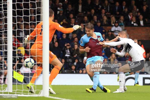 James Tarkowski of Burnley scores his team's second goal during the Premier League match between Fulham FC and Burnley FC at Craven Cottage on August...