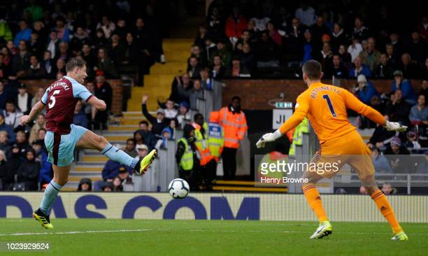 James Tarkowski of Burnley shoots during the Premier League match between Fulham FC and Burnley FC at Craven Cottage on August 26 2018 in London...