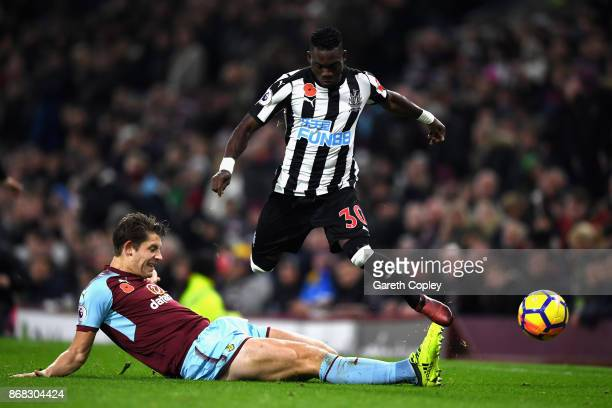 James Tarkowski of Burnley tackled Christian Atsu of Newcastle United during the Premier League match between Burnley and Newcastle United at Turf...
