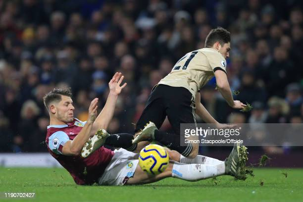 James Tarkowski of Burnley tackles Daniel James of Man Utd during the Premier League match between Burnley FC and Manchester United at Turf Moor on...