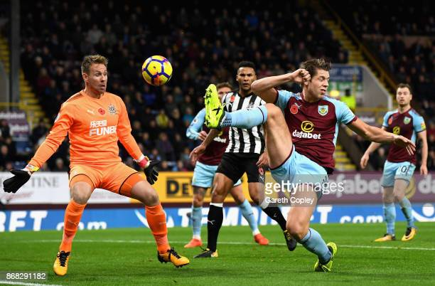James Tarkowski of Burnley takes a shot on goal during the Premier League match between Burnley and Newcastle United at Turf Moor on October 30 2017...