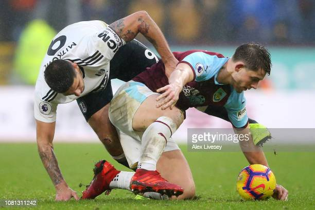 James Tarkowski of Burnley tangles with Aleksandar Mitrovic of Fulham during the Premier League match between Burnley FC and Fulham FC at Turf Moor...