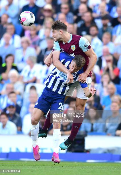 James Tarkowski of Burnley wins a header from Solomon March of Brighton and Hove Albion during the Premier League match between Brighton & Hove...