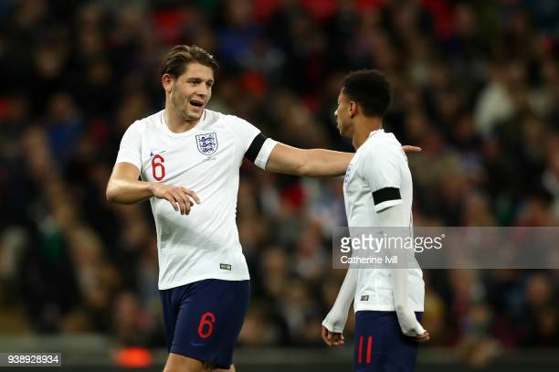 James Tarkowski of England talks to Jesse Lingard during the International Friendly match between England and Italy at Wembley Stadium on March 27...