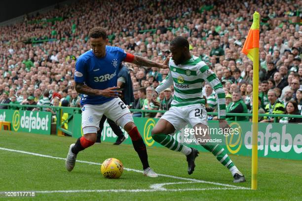 James Tavernier of Rangers battles for possession with Olivier Ntcham of Celtic during the Scottish Premier League match between Celtic and Rangers...