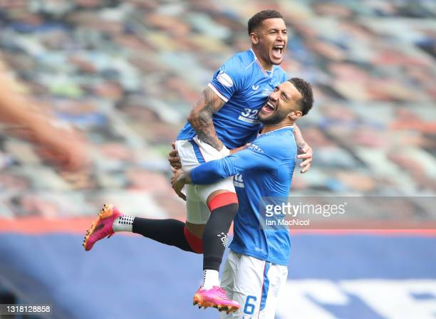 James Tavernier of Rangers celebrates their team's first goal with Connor Goldson, an own goal scored by Joe Lewis of Aberdeen during the Scottish...