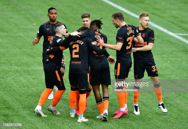 James Tavernier of Rangers celebrates with teammates after scoring his team's first goal during the Ladbrokes Scottish Premiership match between...