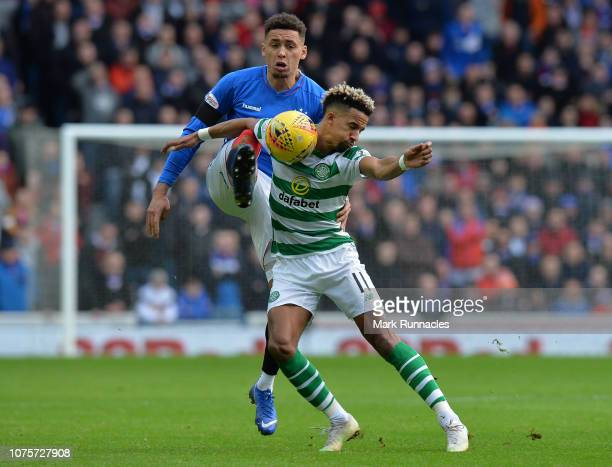 James Tavernier of Rangers challenges Scott Sinclair of Celtic for the ball during the Ladbrokes Scottish Premiership match between Rangers and...