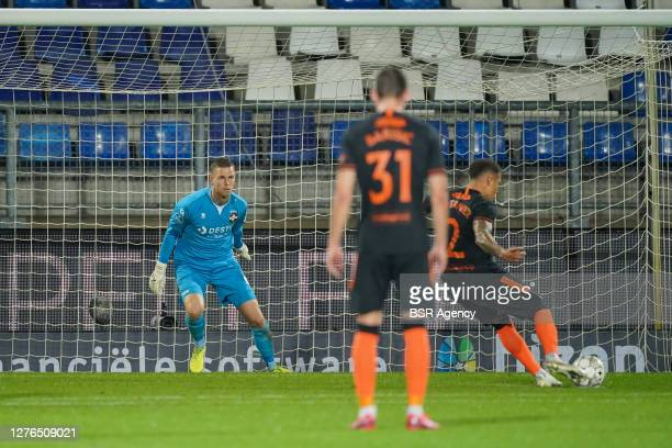 James Tavernier of Rangers FC scores from the penalty spot during the UEFA Europa League third qualifying round match between Willem II and Rangers...