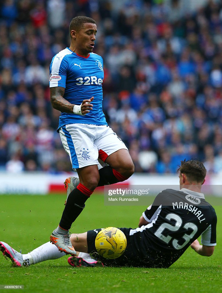 James Tavernier of Rangers is tackled by Jordan Marshall of Queen of the South during the Scottish Championship match between Glasgow Rangers FC and Queen of the South FC at Ibrox Stadium on October 17, 2015 in Glasgow, Scotland.