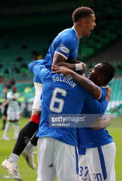 James Tavernier of Rangers jumps on top as Connor Goldson of Rangers celebrates with teammates after scoring his team's first goal during the...