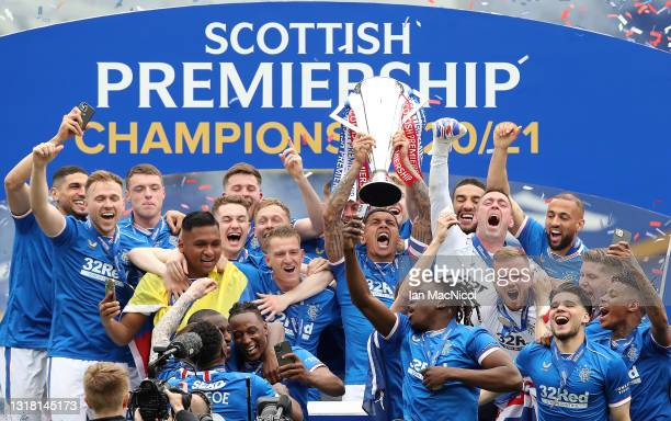 James Tavernier of Rangers lifts the Scottish Premiership Trophy in celebration with team mates following the Scottish Premiership match between...