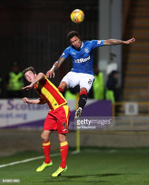 James Tavernier of Rangers out jumps Blair Spittal of Partick Thistle during the Betfred League Cup Quarter Final at Firhill Stadium on September 19...