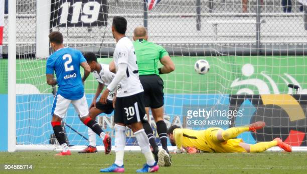 James Tavernier of Scottish club Rangers FC beats goal keeper Caique França of Brazilian club Corinthians for a second half goal during their Florida...