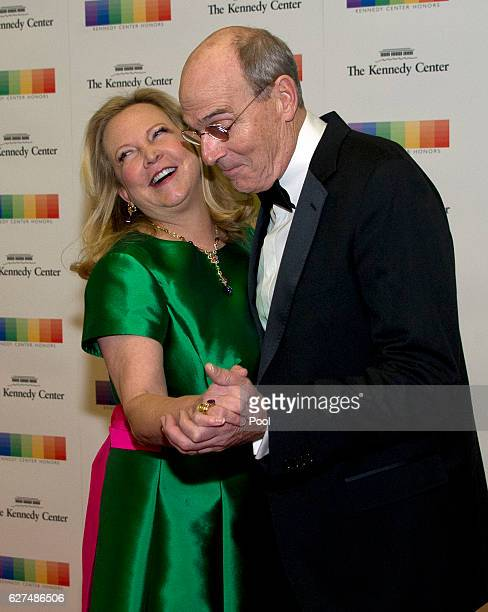 James Taylor and his wife Caroline 'Kim' Taylor dance on the red carpet as they arrive for the formal Artist's Dinner honoring the recipients of the...