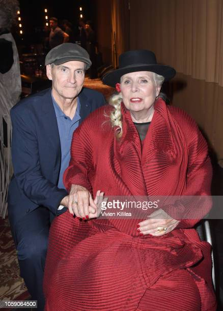 James Taylor and Joni Mitchell attend Joni 75 A Birthday Celebration Live At The Dorothy Chandler Pavilion on November 7 2018 in Los Angeles...