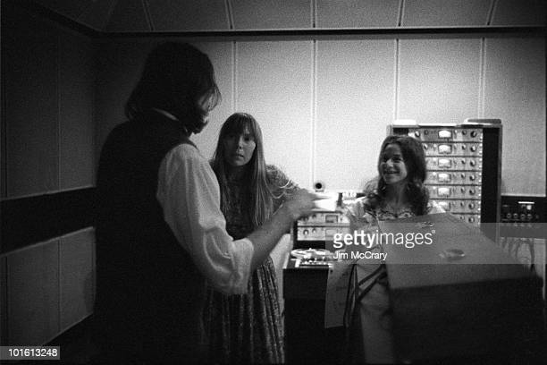James Taylor and Joni Mitchell talk to Carole King in the control room of AM Records Recording Studio during the recording of King's album 'Tapestry'...