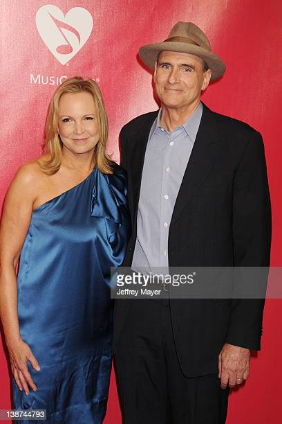 James Taylor and Kim Smedvig arrives at The 2012 MusiCares Person of The Year Gala Honoring Paul McCartney at Los Angeles Convention Center on...