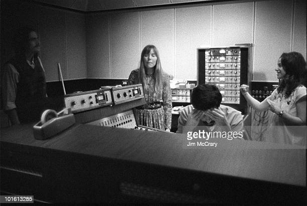 James Taylor Joni Mitchell recording engineer Hank Cicalo and Carole King in the control room of AM Records Recording Studio during the recording of...