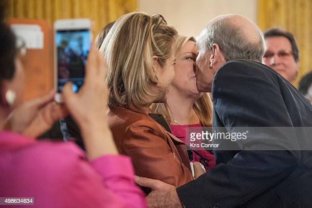 James Taylor kisses his wife Kim Taylor as he leaves the 2015 Presidential Medal Of Freedom Ceremony at the White House on November 24 2015 in...