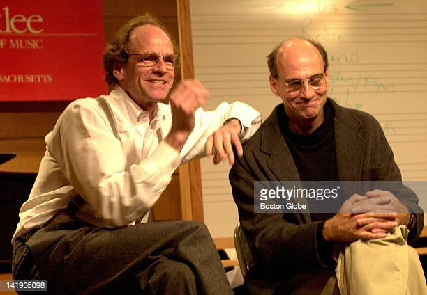 James Taylor, left, talks to students at Berklee College of Music with his brother, Livingston Taylor, who teaches at the school.