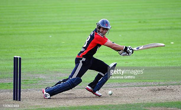 James Taylor of England Lions hits out to the boundary on his way to a century during the One Day International match between England Lions and Sri...