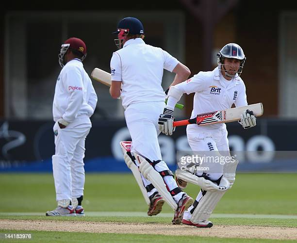 James Taylor of England Lions runs with fellow half centurian Jonny Bairstow of England Lions during day two of the tour match between England Lions...