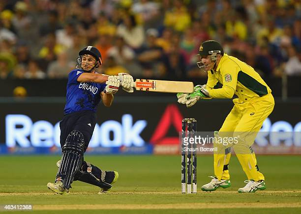 James Taylor plays a shot as Brad Haddin of Australia looks on during the 2015 ICC Cricket World Cup match between England and Australia at Melbourne...