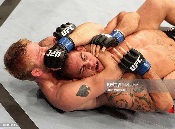 James Te Huna of New Zealand is put in a choke hold by Alexander Gustafsson of Sweden during their Light- Heavyweight bout at UFC 127 at Acer Arena...