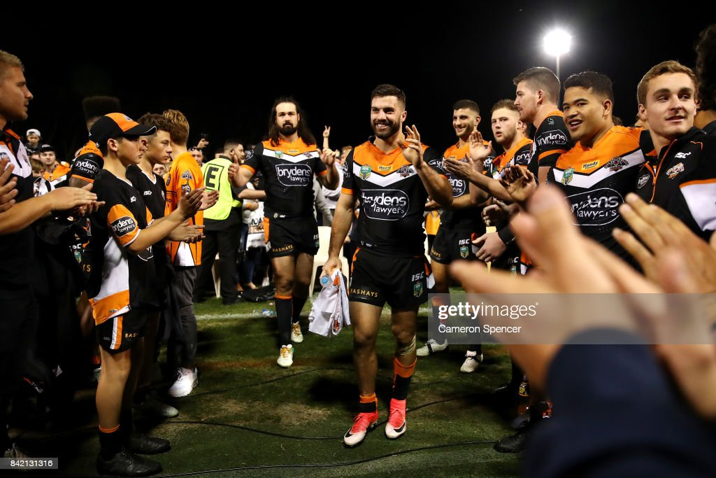 James Tedesco and Aaron Woods of the Tigers are applauded off the field after playing their final game for the Tigers during the round 26 NRL match between the Wests Tigers and the New Zealand Warriors at Leichhardt Oval on September 3, 2017 in Sydney, Australia.