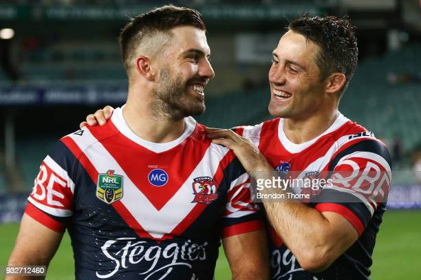 James Tedesco and Cooper Cronk of the Roosters celebrate at full time following the round two NRL match between the Sydney Roosters and the...