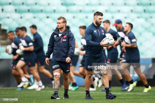 James Tedesco and Jake Friend watch on during a Sydney Roosters NRL training session at Allianz Stadium on September 24 2018 in Sydney Australia
