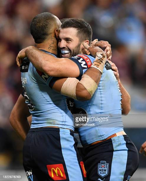 James Tedesco and Josh Addo-Carr of the Blues celebrate the try of Tom Trbojevic of the Blues during game one of the 2021 State of Origin series...