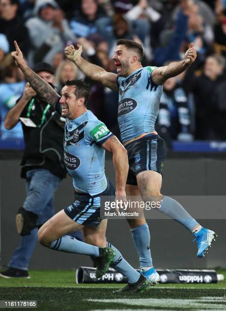 James Tedesco and Mitchell Pearce of the Blues celebrate the match winning try during game three of the 2019 State of Origin series between the New...