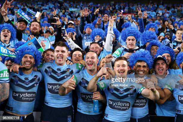James Tedesco Angus Crichton Boyd Cordner Damien Cook and Tyrone Peachey of the Blues celebrate with the crowd after victory in game two of the State...