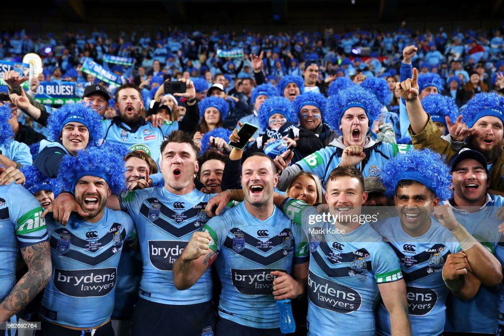 James Tedesco, Angus Crichton, Boyd Cordner Damien Cook and Tyrone Peachey of the Blues celebrate with the crowd after victory in game two of the State of Origin series between the New South Wales Blues and the Queensland Maroons at ANZ Stadium on June 24, 2018 in Sydney, Australia.