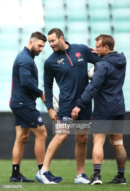 James Tedesco Boyd Cordnerand Jake Friend look on during a Sydney Roosters NRL training session at Allianz Stadium on September 24 2018 in Sydney...