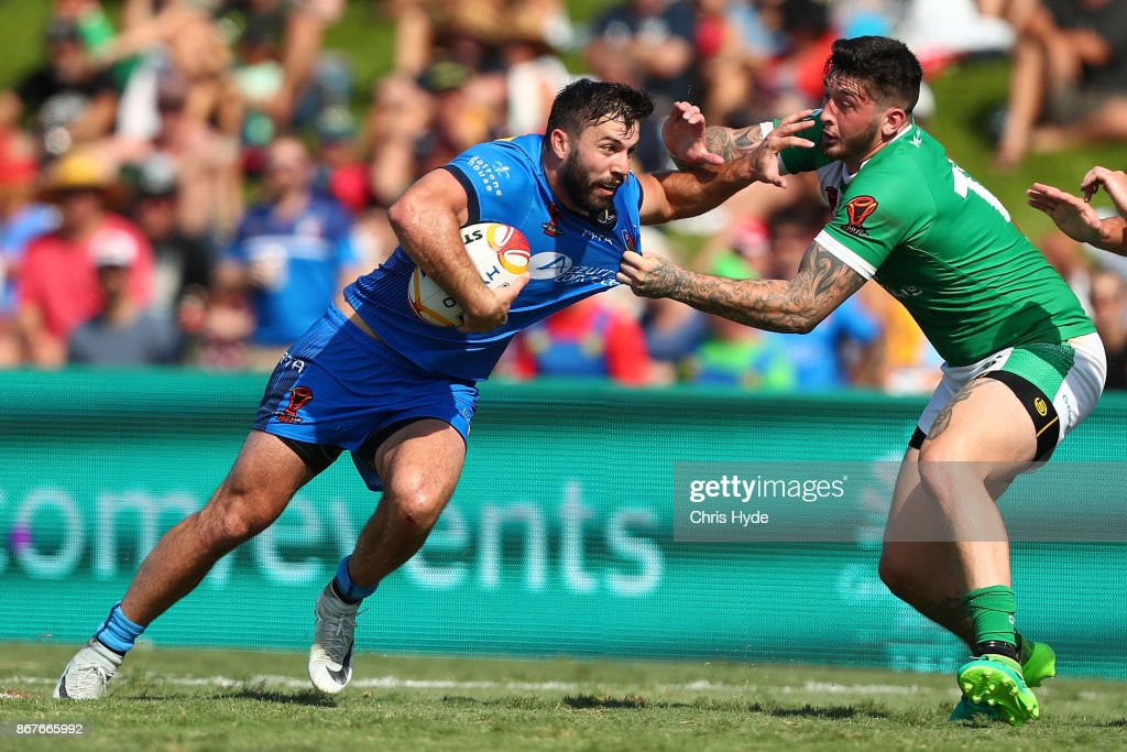 James Tedesco of Italy runs the ball during the 2017 Rugby League World Cup match between Ireland and Italy at Barlow Park on October 29, 2017 in Cairns, Australia.