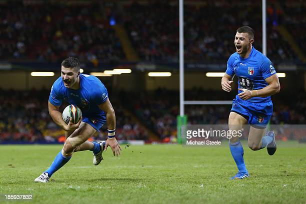 James Tedesco of Italy scores a try with Ben Falcone in support during the Rugby League World Cup Inter group match between Wales and Italy at the...