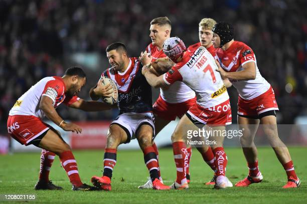 James Tedesco of Sydney Roosters is challenged by players of St Helens during the World Club Series Final between St Helens at Totally Wicked Stadium...