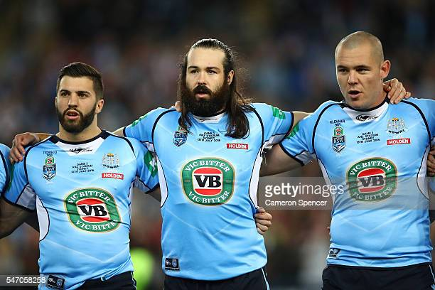 James Tedesco of the Blues Aaron Woods of the Blues and David Klemmer of the Blues sing the national anthem before game three of the State Of Origin...