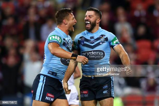 James Tedesco of the Blues celebrates scoring a try with Tariq Sims of the Blues during game three of the State of Origin series between the...