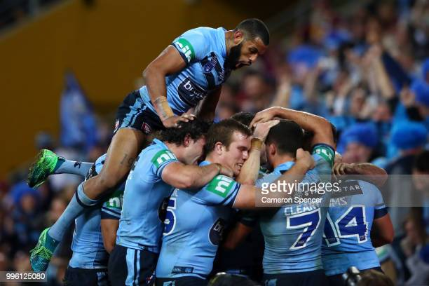 James Tedesco of the Blues celebrates with Josh AddoCarr of the Blues and team mates after scoring a try during game three of the State of Origin...