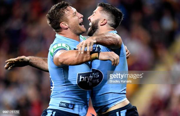 James Tedesco of the Blues celebrates with team mate Ashton Sims after scoring a try during game three of the State of Origin series between the...