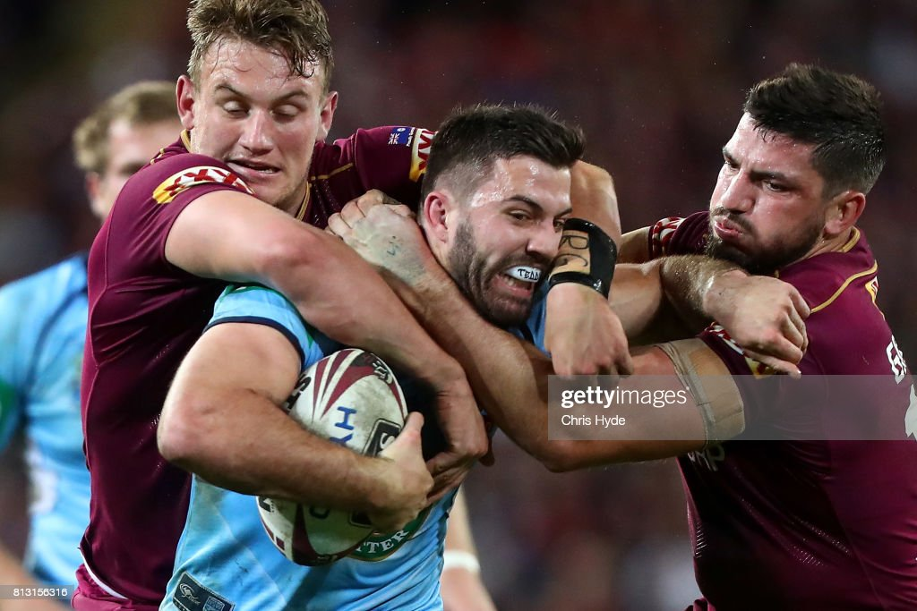 James Tedesco of the Blues is tackled by Coen Hess and Matt Gillett of the Maroons during game three of the State Of Origin series between the Queensland Maroons and the New South Wales Blues at Suncorp Stadium on July 12, 2017 in Brisbane, Australia.