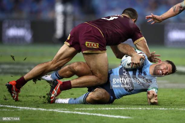James Tedesco of the Blues is tackled by Greg Inglis of the Maroons during game two of the State of Origin series between the New South Wales Blues...