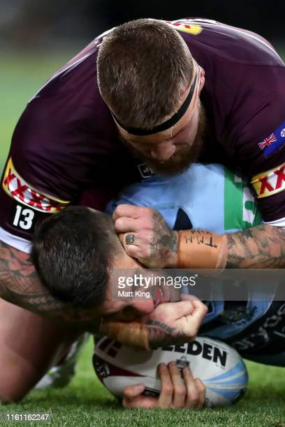 James Tedesco of the Blues is tackled by Josh McGuire of the Maroons during game three of the 2019 State of Origin series between the New South Wales...