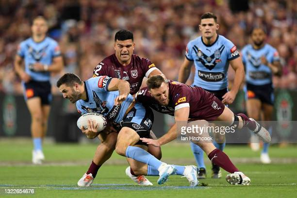 James Tedesco of the Blues is tackled during game one of the 2021 State of Origin series between the New South Wales Blues and the Queensland Maroons...