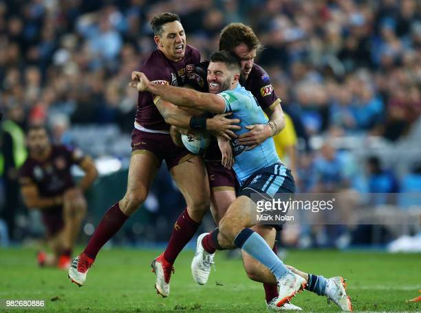 James Tedesco of the Blues is tackled during game two of the State of Origin series between the New South Wales Blues and the Queensland Maroons at...
